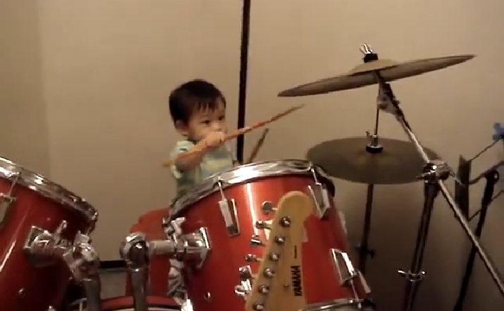 Small Kid Drummer Almost Gets the Drum Beat of the Music