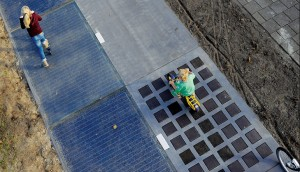 The Evolution of Solar Panel Roadways: Glass Roads and Highways Sandwiching Solar Panels.