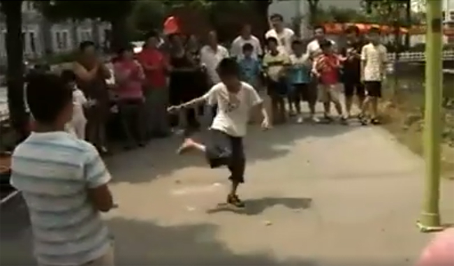Kid Shoe Juggler Attracts Crowd and Does the Unthinkable
